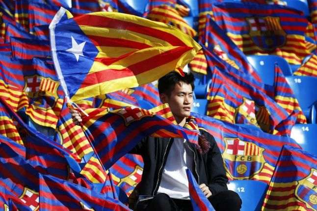 an-fc-barcelona-fan-waves-the-catalan-separatist-flag-the-estelada-before-the-start-of-the-spanish-kings-cup-final-between-fc-barcelona-and-sevilla-fc-in-madrid-by-juan-carlos-hidalgo